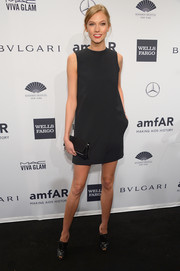 Karlie Kloss chose a pair of black patent leather peep-toe brogues to complete her outfit.