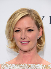 Gretchen Mol looked retro-chic wearing her hair short with curly ends at the amfAR New York Gala.