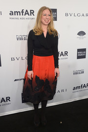 Chelsea Clinton styled her simple top with an elegant floral-embellished ombre skirt.