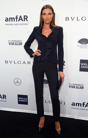 Alina Baikova chose a black pantsuit, made more feminine with ruffles down the front, for the amfAR New York Gala.