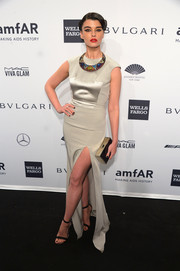 Crystal Renn completed her glam outfit with a gold box clutch.