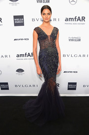 Barbara Fialho stunned in a beaded navy mermaid gown by Mares during the amfAR New York Gala.