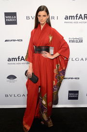 Jeisa Chiminazzo accessorized her exotic dress with a black Bottega Veneta Knot clutch.
