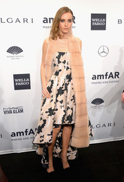 Olga Sorokina donned a black-and-white fishtail dress, styled with a fur scarf, for the amfAR New York Gala.
