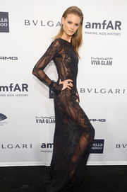 Behati Prinsloo sent pulses racing with this sheer black Emilio Pucci gown during the amfAR New York Gala.