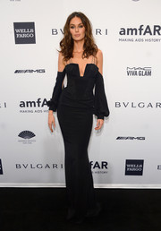Nicole Trunfio smoldered in a cleavage-revealing column dress by Gabriela Cadena during the amfAR New York Gala.