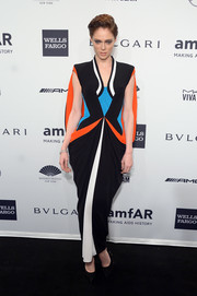 Coco Rocha looked striking, as always, in a caped, color-blocked gown by Jean Paul Gaultier during the amfAR New York Gala.