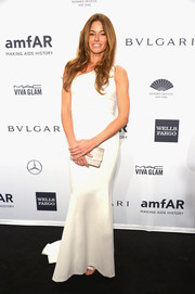 Kelly Bensimon chose a white-hot one-shoulder gown for the amfAR New York Gala.