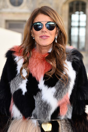 Anna dello Russo made her way to the Dior show wearing ultra-modern sunnies from the brand.