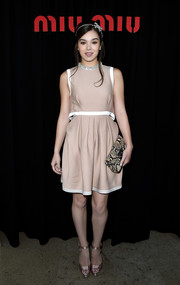 A python clutch by Miu Miu rounded out Hailee Steinfeld's look.