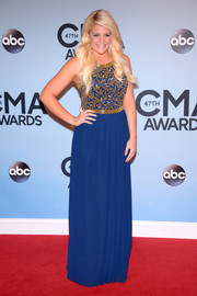 Lauren Alaina chose a blue Virgos Lounge evening dress with gold beading on the bodice for the CMA Awards.