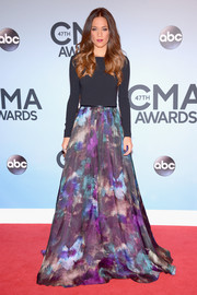 Jana Kramer went for subdued sophistication at the CMA Awards in a long-sleeve Theia gown with a black bodice and a watercolor-print skirt.