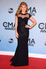 Connie Britton went for subtle sexiness in a tight-fitting sheer-panel black evening dress by Georges Hobeika during the CMA Awards.