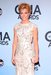 Kimberly Perry complemented her lovely dress with a nude Swarovski box clutch when she attended the CMA Awards.