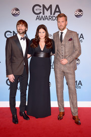 Hillary Scott kept it simple in a black evening dress with a matching bolero when she attended the CMA Awards.
