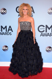 Kimberly Schlapman channeled her inner princess in a strapless gown with a bejeweled bodice and a voluminous fur-embellished skirt during the CMA Awards.