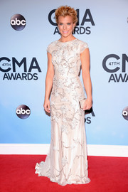 Kimberly Perry looked ultra elegant in an embroidered white evening dress by Johanna Johnson during the CMA Awards.