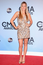 Colbie Caillat showed off those fabulous legs at the CMA Awards in a sophisticated Nicole Miller mini dress featuring geometric beading.