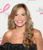 Maria Jose Barraza wore her hair in a cascade of curls during the Hot Pink Party.