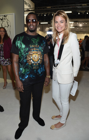 Sean Combs attended the 2012 Art Basel Miami Beach VIP preview wearing a vibrant Gucci print T-shirt.