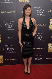 Aubrey Plaza looked foxy in a sequined black halter dress by Georges Chakra at the Art Directors Guild Awards.