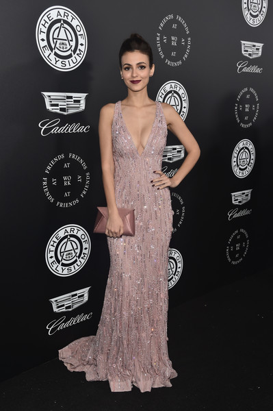 Victoria Justice matched her gown with a pink satin envelope clutch by Tyler Ellis.