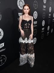 Madelaine Petsch went for a boudoir-glam vibe with this black-and-white lace corset gown by Fabiana Milazzo at the Art of Elysium Heaven Gala.
