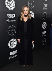 Maria Bello gave us rock star vibes with this long black velvet coat at the Art of Elysium Heaven Gala.