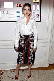 Camilla Belle added an extra pop of color with a pair of red patent pumps by Gucci.