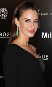 Jessica paired her half up half down 'do with jade green earrings.