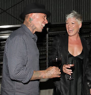 While sharing a laugh with Pink, Carey showed off his angel tattoo on his neck.