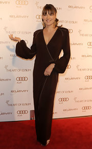 Lucy Lawless wore a genie-inspired dress for the Art of Alysium Gala.
