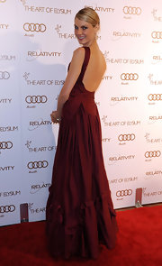 Angela Lindvall looked stunning in a backless Merlot evening dress at the Art of Elysium Gala.