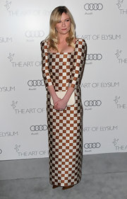 Kirsten Dunst showed some serious style moxie in this checkered floor-length dress at the Art of Elysium Heaven Gala.