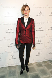 Evan Rachel Wood chose black skinny pants by Moschino Cheap & Chic to complete her menswear-inspired outfit.