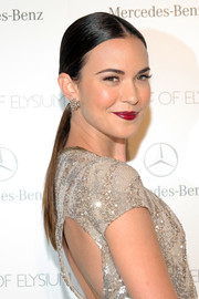 Odette Annable topped off her look with a super-sleek center-parted ponytail when she attended the Art of Elysium's Heaven Gala.