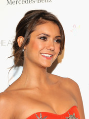 Nina Dobrev pulled her hair up into a lovely chignon for the Art of Elysium's Heaven Gala.