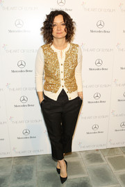 Sara Gilbert was casual-glam in a gold sequined cardigan at the Art of Elysium's Heaven Gala.