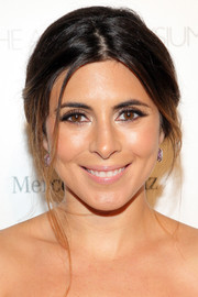 Jamie-Lynn Sigler chose a soft center-parted updo to complete her Heaven Gala look.