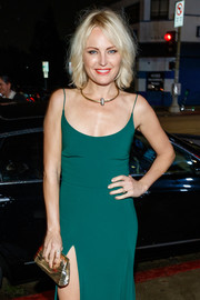 Malin Akerman paired a gold clutch with a green slip dress for the Art of Elysium Heaven celebration.