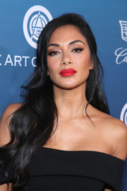 Nicole Scherzinger wore her long tresses down in a gently wavy style at the Art of Elysium Heaven celebration.