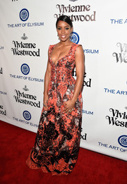 Kelly Rowland walked the Heaven Gala red carpet wearing a low-cut, heavily embroidered gown.