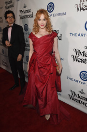 Christina Hendricks looked every bit the belle of the ball in her draped red Vivienne Westwood Couture gown at the Heaven Gala.