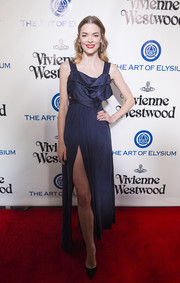 Jaime King flashed some leg at the Heaven Gala in a navy Vivienne Westwood Haute Couture dress with a high slit and an architectural bodice.