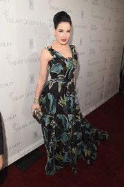 Dita Von Teese added glitter to her print dress via a luxurious beaded clutch.