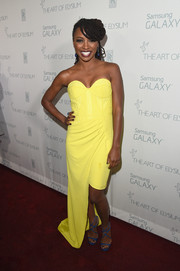 Unafraid of color, Shanola Hampton paired her yellow dress with blue Jimmy Choo Lance sandals.