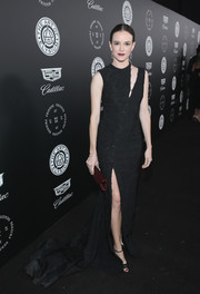 Danielle Panabaker went for modern glamour in a slashed black fishtail gown by Eleanor Balfour at the Art of Elysium Heaven Gala.