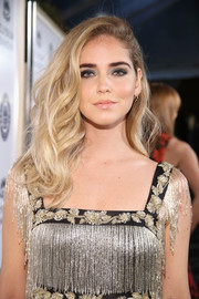 For her beauty look, Chiara Ferragni shunned color, opting instead for smoky gray eyeshadow and neutral lipstick.