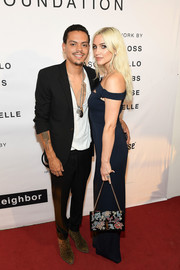 Ashlee Simpson attended the Art with a Cause VIP reception carrying an embroidered chain-strap bag by YSL.