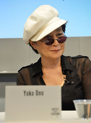 Yoko Ono donned a pair of her trademark oval lenses in a distinct purple hue at the Artists Against Fracking Coalition Event.